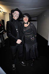 CAROLINE BURSTEIN-COLLIS and her husband MICHAEL COLLIS at the 3rd annual Browns Focus Halloween Party held at the Shepherd's Bush Pavilion, London W12 on 30th October 2009.