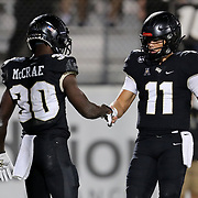 ORLANDO, FL - NOVEMBER 14:  Dillon Gabriel #11 of the Central Florida Knights and Greg McCrae #30 of the Central Florida Knights high five in a game against the Temple Owls at Bounce House-FBC Mortgage Field on November 14, 2020 in Orlando, Florida. (Photo by Alex Menendez/Getty Images) *** Local Caption *** Dillon Gabriel; Greg McCrae