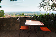 Two chairs and a table in the shade with a view over the landscape at The restaurant Le Verger de Papes in Chateauneuf-du-Pape Châteauneuf, Vaucluse, Provence, France, Europe