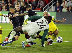 November 1, 2018 - Washington, DC, USA - Columbus Crew SC forward Federico Higuain (10) scores a goal past D.C. United goalkeeper Bill Hamid (24) during the first half of the MLS Cup knockout round playoff match at Audi Field in Washington, D.C., on Thursday, Nov. 1, 2018. (Credit Image: © Adam Cairns/Columbus Dispatch/TNS via ZUMA Wire)