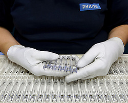 Another step in the quality control process in the manufacturing of ceramic metal halide lamps, at the Philips Lighting factory, in Turnhout, Belgium, on Friday, Oct. 15, 2010. (Photo © Jock Fistick)