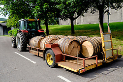 Barrels of new whisky being transported to warehouse for ageing at Macallan  whisky distillery on Speyside in Scotland United Kingdom
