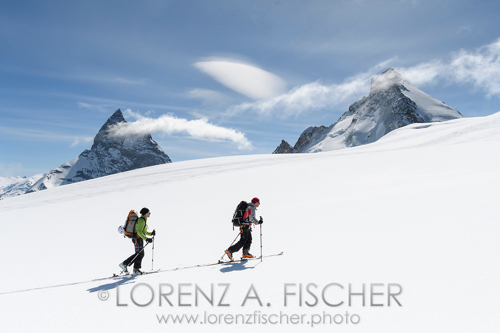 Matterhorn and Dent d'Herens and two alpinists on the Stockjigletscher, Valais, Switzerland