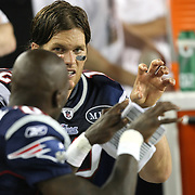 New England quarterback Tom Brady (12) and wide receiver Chad Ochocinco (85) talk about play selection on the bench during an NFL football game between the New England Patriots and the Tampa Bay Buccaneers at Raymond James Stadium on Thursday, August 18, 2011 in Tampa, Florida.   (Photo/Alex Menendez)