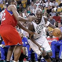 26 May 2012: Boston Celtics power forward Kevin Garnett (5) drives past Philadelphia Sixers power forward Elton Brand (42) during the Boston Celtics 85-75 victory over the Philadelphia Sixer, in Game 7 of the Eastern Conference semifinals playoff series, at the TD Banknorth Garden, Boston, Massachusetts, USA.