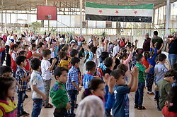 Schoolchildren attend an event at their school's yard, in the northern town of Jisr al-Shughur, Syria, west of the city of Idlib. Syrian government forces, backed by Russia and Iran, have been massing troops for weeks in preparation for an attack on Idlib province, the last major rebel stronghold in the country. The U.N. has warned that a battle will spark a humanitarian catastrophe. Syria, September 11, 2018. Photo by Ugur Can/DHA/ABACAPRESS.COM