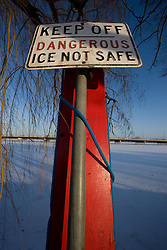 A sign posted near Lake Nokomis warns of unsafe ice conditions.