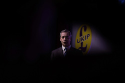 """© London News Pictures. """"Looking for Nigel"""". A body of work by photographer Mary Turner, studying UKIP leader Nigel Farage and his followers throughout the 2015 election campaign. PICTURE SHOWS - Nigel takes to the stage during the UKIP Spring Conference in the Winter Gardens theatre in Margate, Kent on February 27th 2015 to give one of his most rousing speeches to the assemble UKIP supporters who had arrived from all around the country to attend the event. . Photo credit: Mary Turner/LNP **PLEASE CALL TO ARRANGE FEE** **More images available on request**"""