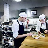 Nederland, Lelystad.16 juli 2012..Keuken van Marfo.Een kijkje in de keuken van Marfo,de grootstevliegtuigcateraarvan Nederland. Wie maken het vliegtuigvoedsel? Hoe maken ze het? Is het terecht dat vliegtuigvoedsel een scheldnaam is geworden? Pascal Jalhaij, die wordt beschouwd als één van de meest talentvolle koks van zijn generatie, is de chefkok hier..Op de foto Pascal Jalhaij samen met een kok in de voorproefkeuken waar de maaltijden op kwaliteit worden geproefd en eventueel verbeterd..A peek into the kitchen of Marfo, the largest airplane caterer in the Netherlands.  Is airplane food a term of abuse?