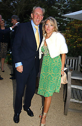 VISCOUNT & VISCOUNTESS DAVENTRY at the annual Cartier Flower Show Diner held at The Physics Garden, Chelsea, London on 23rd May 2005.<br />