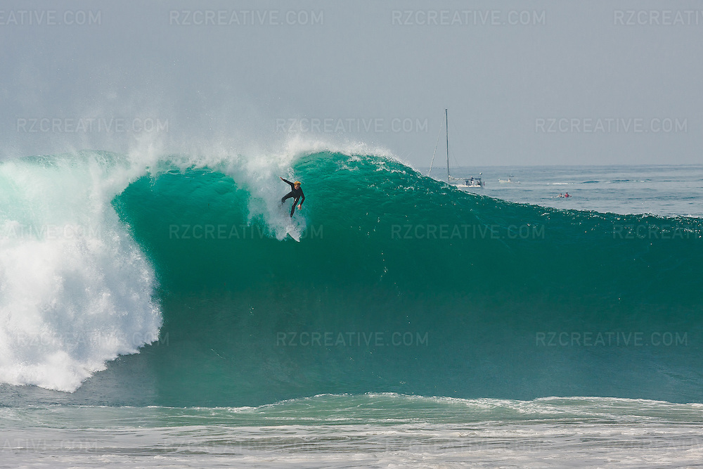 Surfer drops into a large wave during a summer south swell at the Wedge in Newport Beach, California. Photo by Robert Zaleski/rzcreative.com