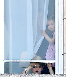 Prince George picks his nose as he and Princess Charlotte watch Trooping the Colour at Buckingham Palace, London, UK, on the 17th June 2017. 17 Jun 2017 Pictured: Prince George, Princess Charlotte. Photo credit: James Whatling / MEGA TheMegaAgency.com +1 888 505 6342