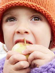 Close up of Young Girl Eating an Apple