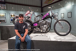 Justin McNeely beside his bike at the Old Iron - Young Blood exhibition media and industry reception in the Motorcycles as Art gallery at the Buffalo Chip during the annual Sturgis Black Hills Motorcycle Rally. Sturgis, SD. USA. Sunday August 6, 2017. Photography ©2017 Michael Lichter.