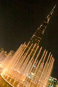 The famous Burj Khalifa, the tallest building in the world, as of 2021 in Dubai, United Arab Emirates with the evening water show in the lagoon