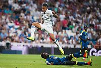 Real Madrid's player Mariano Diaz Mejia and Celta de Vigo's player Pape during a match of La Liga Santander at Santiago Bernabeu Stadium in Madrid. August 27, Spain. 2016. (ALTERPHOTOS/BorjaB.Hojas)