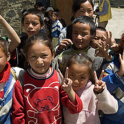 Local children of village people in Chanang (Dranang) in Tibetan countryside. Asia.