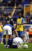 Photo: Mark Stephenson.<br /> Birmingham City v Hereford United. Carling Cup. 28/08/2007.Hererford's Tho Robinson gets a yellow card from referee Mr M Atkinson