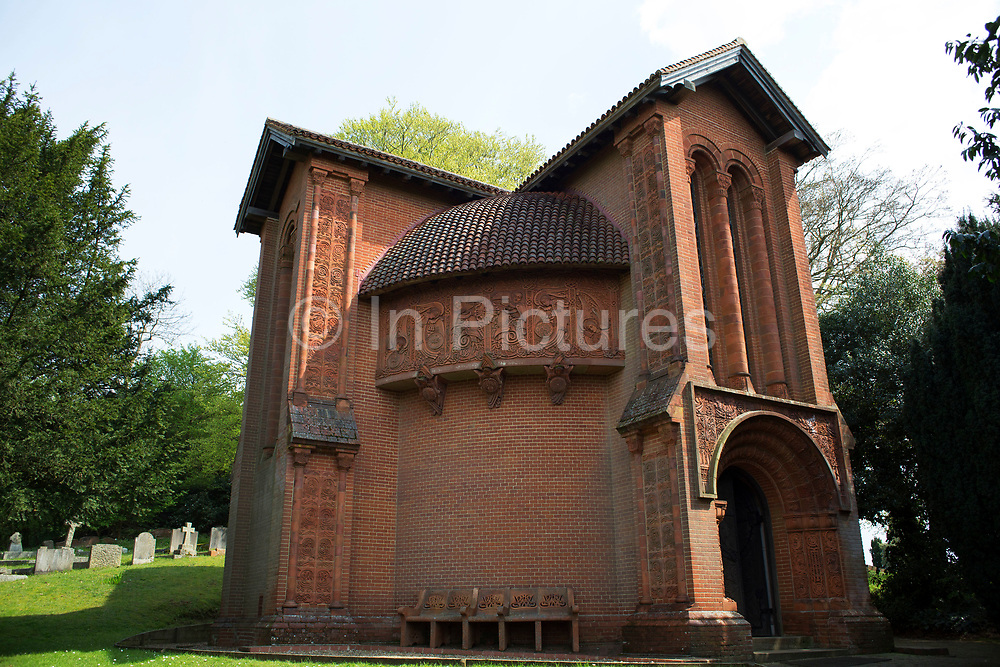 Watts Chapel is a Grade 1 listed Chapel situated in the village of Compton in Surrey. Watts Chapel was designed by Mary Watts, wife of Internationally renowned Victorian artist, George Frederic Watts who funded the project. Both are now buried at the cemetery, as are, many of the residents who helped Mary decorate this beautiful Chapel. The Chapel is a wonderful fusion of influences, including Art Nouveau, Celtic, Romanesque and Egyptian. It is built on a grassy mound and the deep red terracotta brickwork contrasts with striking effect against the cemetery landscape. Inside, the brightly coloured designs and symbols representing the tree of life, fill the dome shaped interior. Compton,