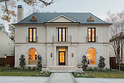 Front exterior photography of a traditional home in Highland Park at dusk.