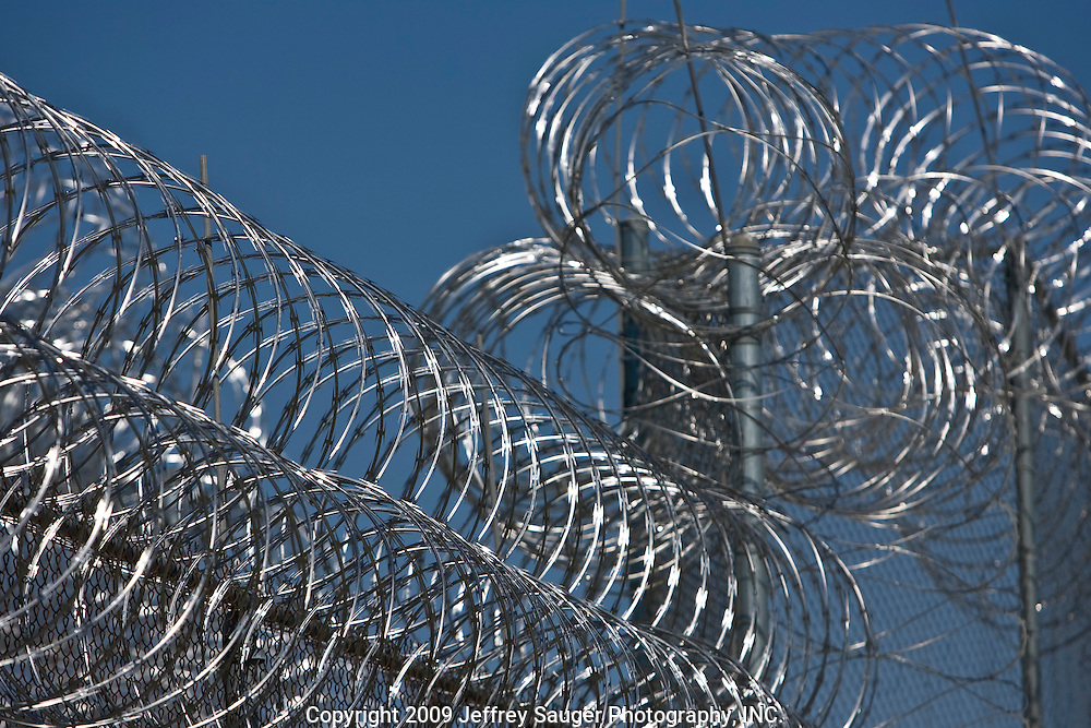 Razor wire surrounds Deerfield Correctional Facility's empty yard after the last 33 of 1,200 prisoners were transported out of the closing prison in Ionia, MI, Friday, March 20, 2009. The prisoners were transferred to West Shoreline Correctional Facility in Muskegon, MI.