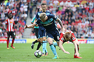 Middlesbrough midfielder Adam Clayton (8)  stops Sunderland forward Duncan Watmore (14)  during the Premier League match between Sunderland and Middlesbrough at the Stadium Of Light, Sunderland, England on 21 August 2016. Photo by Simon Davies.