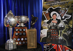Art Ross Trophy, , awarded annually to the National Hockey League`s top scorer; Hart Memorial Trophy, for the NHL`s most valuable player; and Lester B.Pearson Trophy, for the most outstanding player as voted by fellow players. The trophies, which Cole Harbour`s Sidney Crosby won during the 2006-2007 season, are on loan to the Nova Scotia Sport Hall of Fame, photographed  on May 11, 2008 in Metro center, Halifax, Canada.  (Photo by Vid Ponikvar / Sportal Images)