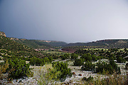 A thunderstorm passes the Canadian River gorge about 20 miles west of Wagon Wheel, New Mexico