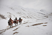Three Kyrgyz horsemen going up to the Pamir, a 5 days journey. From Kher Metek to Langar...Trekking back down from the Little Pamir, with yak caravan, over the frozen Wakhan river.