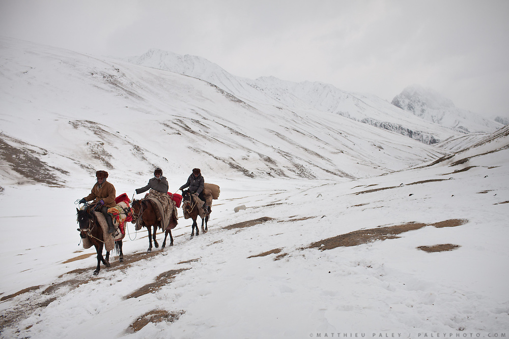 Three Kyrgyz horsemen going up to the Pamir, a 5 days journey. From Kher Metek to Langar...Trekking back down from the Little Pamir, with yak caravan, over the frozen Wakhan river.