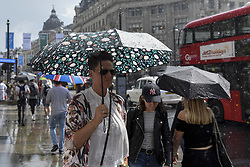 June 2, 2017 - London, UK - London UK. Commuters, shoppers and tourists react to a sudden thunderstorm which brings a heavy downpour to Oxford Street. (Credit Image: © Stephen Chung/London News Pictures via ZUMA Wire)