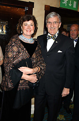 Football correspondent JIMMY HILL Life president of SPARKS and his wife BRYONY at the annual SPARKS Winter Ball in the presence of HRH Princess Michael of Kent held at the London Hilton Hotel, Park Lane, London W1 on 15th December 2005.<br /><br /><br />NON EXCLUSIVE - WORLD RIGHTS