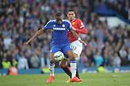 Didier Drogba of Chelsea is challenged Chris Smalling of Manchester United. Barclays Premier league match, Chelsea v Manchester Utd at Stamford Bridge Stadium in London on Saturday 18th April 2015.<br /> pic by John Patrick Fletcher, Andrew Orchard sports photography.