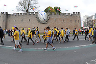 Australian fans walk past Cardiff castle on their way to the ground. Rugby World Cup 2015 pool A match, Australia v Fiji at the Millennium Stadium in Cardiff, South Wales  on Wednesday 23rd September 2015.<br /> pic by  Andrew Orchard, Andrew Orchard sports photography.