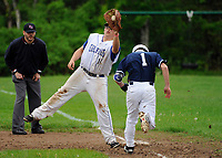 Gilford's Isaac Wallace makes the out at first on 1/Bosse from White Mountain during NHIAA division III baseball Tuesday afternoon. (Karen Bobotas/for the Laconia Daily Sun)