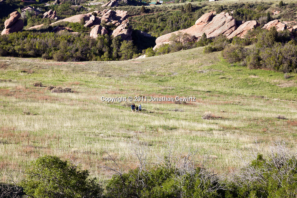 Hikers walking on a trail in the South Valley Park Ken-Caryl Ranch Open Space in Colorado. WATERMARKS WILL NOT APPEAR ON PRINTS OR LICENSED IMAGES.