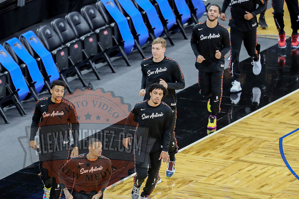 ORLANDO, FL - APRIL 12: San Antonio Spurs players enter the court against the Orlando Magic prior to their game at Amway Center on April 12, 2021 in Orlando, Florida. NOTE TO USER: User expressly acknowledges and agrees that, by downloading and or using this photograph, User is consenting to the terms and conditions of the Getty Images License Agreement. (Photo by Alex Menendez/Getty Images)*** Local Caption ***
