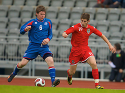 REYKJAVIK, ICELAND - Wednesday, May 28, 2008: Wales' Ched Evans in action against Iceland's Aron Gunnarsson on his debut during the international friendly match at the Laugardalsvollur Stadium. (Photo by David Rawcliffe/Propaganda)