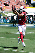 Arizona Cardinals wide receiver Larry Fitzgerald (11) leaps and catches a pass during pregame warmups before the 2018 NFL regular season week 2 football game against the Los Angeles Rams on Sunday, Sept. 16, 2018 in Los Angeles. The Rams won the game in a 34-0 shutout. (©Paul Anthony Spinelli)