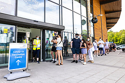 © Licensed to London News Pictures. 02/06/2021. Manchester, UK. People queue up for the vaccination . The NHS has set up a Covid vaccination clinic at the Irish World Heritage Centre in Cheetham Hill, North Manchester . All residents over 18 living in hotspots across the city are being invited to turn up for the Pfizer Coronavirus vaccine without needing to make an appointment or provide ID . Photo credit: Joel Goodman/LNP