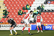 Fleetwood Town's defender Charlie Mulgrew (14) heads the ball during the EFL Sky Bet League 1 match between Fleetwood Town and Accrington Stanley at the Highbury Stadium, Fleetwood, England on 27 February 2021.