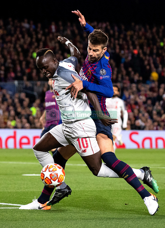 BARCELONA, May 2, 2019  FC Barcelona's Gerard Pique (R) vies with Liverpool's Sadio Mane during the UEFA Champions League semifinal first leg soccer match between FC Barcelona and Liverpool in Barcelona, Spain, on May 1, 2019. Barcelona won 3-0. (Credit Image: © Joan Gosa/Xinhua via ZUMA Wire)