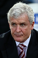 Mark Hughes, the Stoke City manager looks on from the dugout before k/o. Barclays Premier league match, West Ham Utd v Stoke city at the Boleyn Ground, Upton Park  in London on Saturday 12th December 2015.<br /> pic by John Patrick Fletcher, Andrew Orchard sports photography.