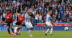 Manchester United's Scott McTominay scores his side's first goal of the game during the Premier League match at the John Smith's Stadium, Huddersfield.