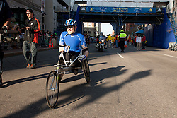 wheelchair division winner after crossing finish line