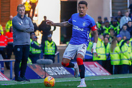 James Tavernier (C) of Rangers FC on the ball as a disconsolate Interim Celtic Manager Neil Lennon looks on  during the Ladbrokes Scottish Premiership match between Rangers and Celtic at Ibrox, Glasgow, Scotland on 12 May 2019.