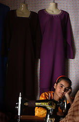 KABUL,AFGHANISTAN - SEPT. 10:  Afghan girls learn too sew September 10, 2002 in Kabul, Afghanistan. (Photo by Ami Vitale/Getty Images)