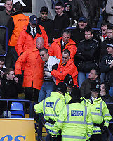 Photo: Paul Thomas.<br />Bolton Wanderers v Manchester City. The Barclays Premiership. 21/01/2006.<br />A Bolton fan gets thrown out of the game.