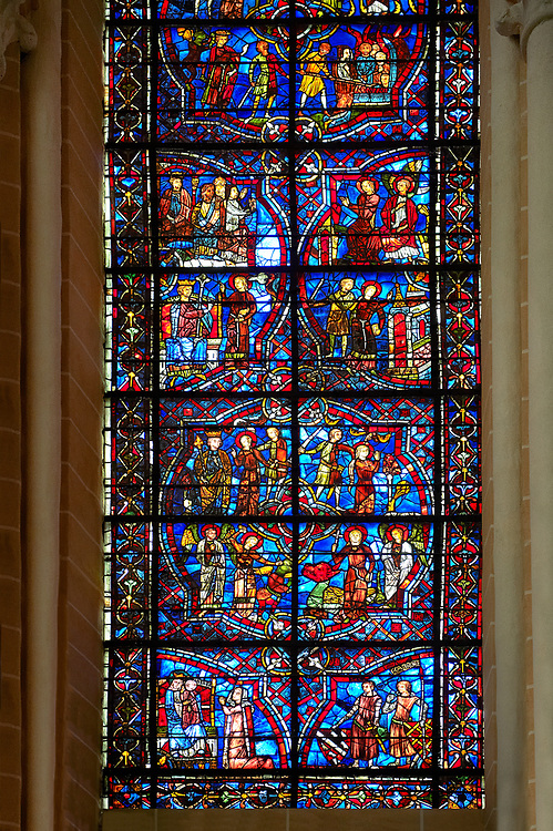 Medieval stained glass Window of the Gothic Cathedral of Chartres, France - dedicated to the life of St Margret and St Catherine.  A UNESCO World Heritage Site.. .<br /> <br /> Visit our MEDIEVAL ART PHOTO COLLECTIONS for more   photos  to download or buy as prints https://funkystock.photoshelter.com/gallery-collection/Medieval-Middle-Ages-Art-Artefacts-Antiquities-Pictures-Images-of/C0000YpKXiAHnG2k