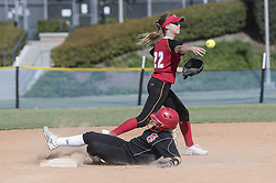 April 3, 2017 - Irvine, California, USA - Woodbridge's Dana Demo throws to first after getting Garden Grove's Blake Hesla out at Second during the The Alan Dugard Woodbridge Softball Classic in Irvine, California, on Monday, April 3, 2017. (Credit Image: © Jeff Gritchen/The Orange County Register via ZUMA Wire)